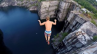 Daredevils Show the Camera How to Dive From Cliffs Into Water - Video