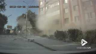 Truck carrying flour crashes into an apartment building