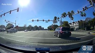 Video catches driver creeping through intersection, running red light