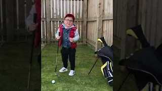 'Keep Your Eye on the Ball Noel!' - Little Boy Learns to Golf - Video