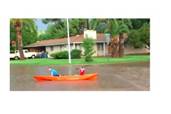 Kayakers Hit the Streets After Monsoon Causes Flash Flooding in Tucson - Video