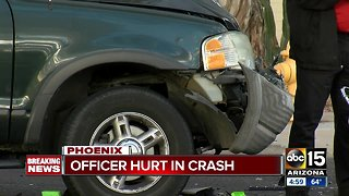 Motorcycle officer hospitalized after north Phoenix crash