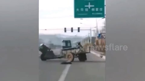 Out-of-control tractor does doughnuts on road while hapless driver chases