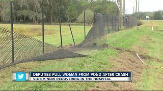Deputies pull woman from pond - Video