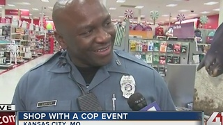Officers & kids shop for presents at Shop with a Cop