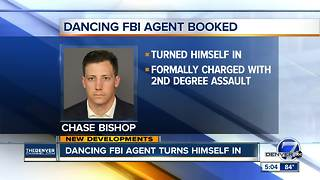 Dancing FBI agent accused in shooting at Denver bar charged with felony second-degree assault