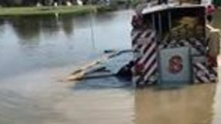 Texas Residents Use Trucks to Rescue Fire Engine Stuck in Floodwater - Video