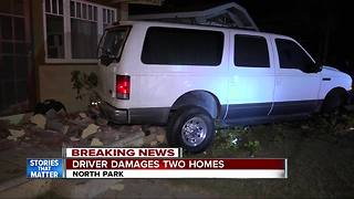 SUV slams into two North Park homes - Video