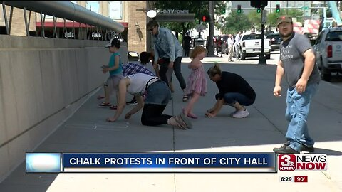 Chalk protests in front of City Hall