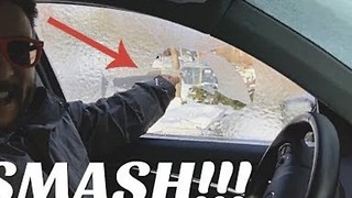 Guy Smashes Frozen Window in an Extremely Satisfying Way - Video