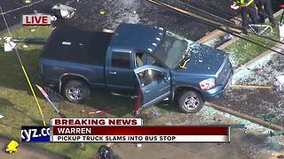 Pickup truck slams into Warren bus stop