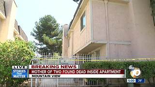 Mother dead in home with children - Video