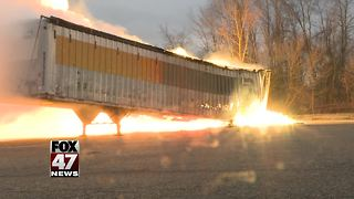 Crews monitor trailer fire burning at Mid-Michigan business - Video