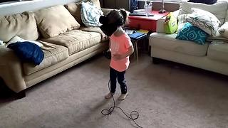 Little girl falls in love with VR experience - Video