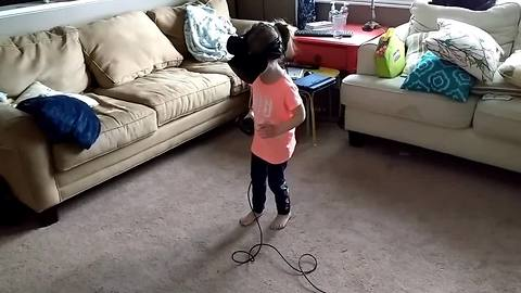 Little girl falls in love with VR experience