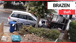 Brazen thieves caught stealing parked car by towing it away in broad daylight