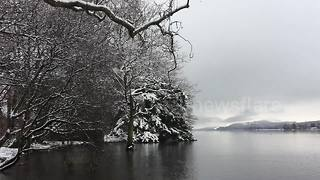 Snow blankets Lake District as UK temperatures fall - Video