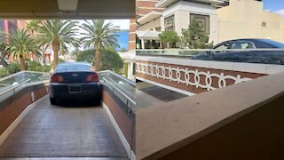 Authorities arrest driver for suspected DUI after car spotted on pedestrian bridge in Las Vegas