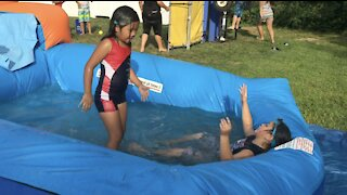 Slip and Slide Water Sliding Fun Challenge at Summer Birthday Party pre-Covid19
