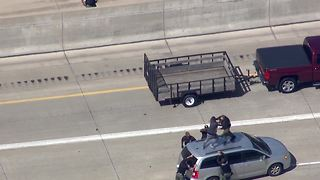 Watch as police tackle a chase suspect on top of a car - Video