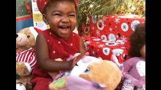 Adorable Tot Shows Off Her Christmas Presents