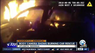 Police body cam shows Atlanta officer rescue driver from burning car - Video