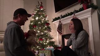Man allergic to dogs surprises wife with puppy for Christmas - Video
