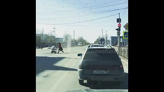 Dust devil chases old lady across street in Russia - Video