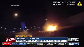 Body cam footage shows dramatic rescue from fiery wreck