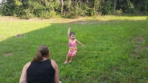 Tot Girl Keeps Falling On The Grass