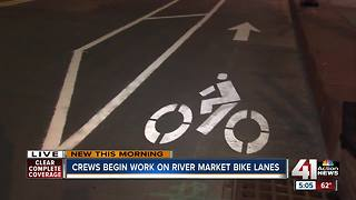 Crews begin work on River Market bike lanes - Video