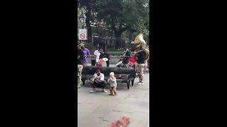 Watch this adorable toddler jam with a New Orleans brass band - Video