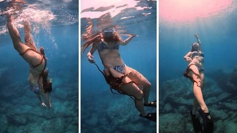 Woman Dives In The Ocean With Octopus Attached To Her Leg