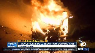 Two officers pull teen from burning car
