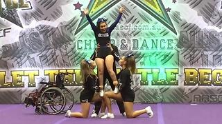 Cheerleader Battling Cancer Gets Unexpected Support From Football Team - Video