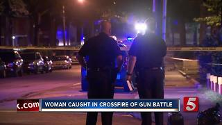 Woman Caught In Crossfire Of Gun Battle - Video