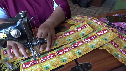 Sewing plastic waste into bags and aprons in Indonesia