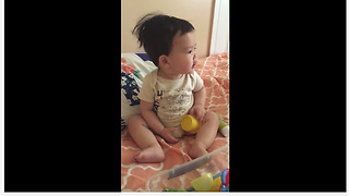 Baby dances to rhythm of ceiling fan
