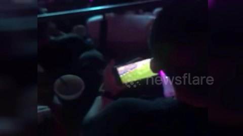 Man watches World Cup on phone while at Jay Chou concert