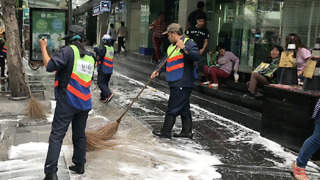 Street Cleaners On Silom Road
