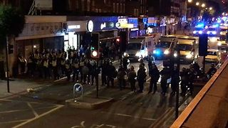 Police, in Riot Gear and on Horseback, Charge Down London Street - Video
