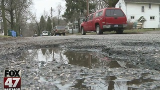 Unusual January weather causing more potholes on roads - Video