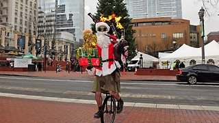Unicycling Santa Plays 'Ode to Joy' on Flaming Bagpipes - Video