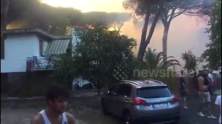 Forest fire threatens homes in central Italy