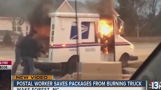 Postal worker saves Christmas after truck fire - Video