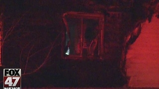 Fire damages house in Lansing - Video