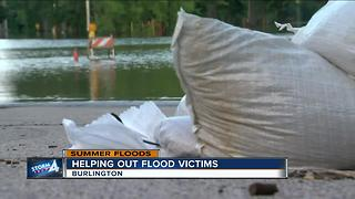 Community reaches out to flooding victims - Video