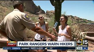 Park rangers warning hikers about heat - Video