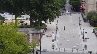 People running in front of Notre-Dame cathedral in Paris - Video