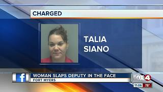 Woman Slaps Deputy in the Face - Video